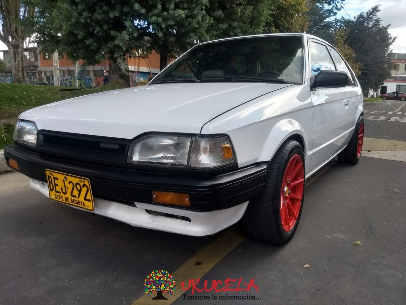 vendo mazda 323 coupe impecable